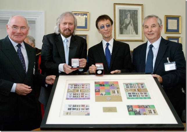 Barry & Robin receive the IOM stamps and coins